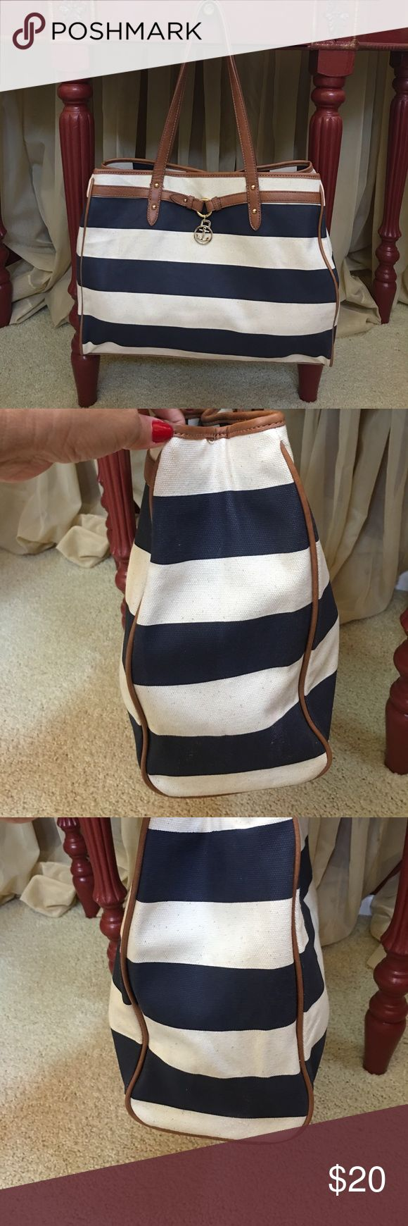 Tommy Hilfiger tote bag Canvas tote bag, Navy blue with cream color. Tan brown handles, bottom and piping. With gold hardware. It has one zipper pocket inside and two open pockets. Great for traveling.⛴🛫🏝 Tommy Hilfiger Bags Totes