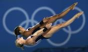 Sarah Barrow (foreground) and Tonia Couch of Great Britain compete in the Women's Synchronized 10m Platform Diving on Day 4 of the London 2012 Olympic Games at the Aquatics Centre — Clive Rose, Getty Images, July 31, 2012