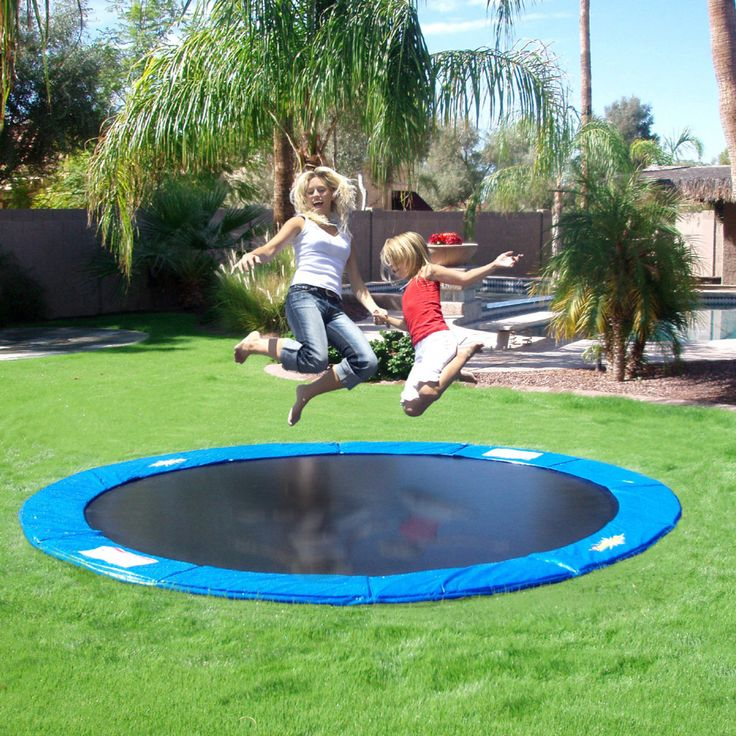 In-Ground Trampoline.... it is safer and looks much better than the Above Ground trampolines.... found at www.in-groundtrampolines.com