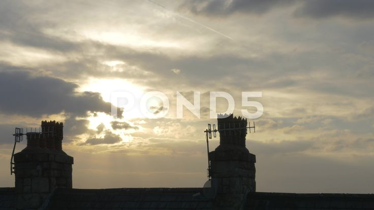 4k Time Lapse Birds On Chimneys Roof Top Sun Through Clouds - Stock Footage | by RyanJonesFilms