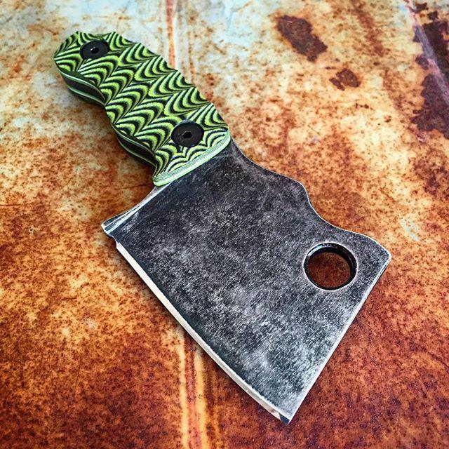 Rhino cleaver with toxic green scales with white and toxic green liners. Dark acid stonewash and a razor sharp edge.   #jurrasicworld #jurrasicpark #knifemaking #knifecommunity #knifeporn #tactical #tacticool #skinner #colorado #hunting #edc #survival #selfdefense #custom #handmade  #wanderlustblades #cleaver #kydex #everydaycarry #knifesale #usnstagram #tacticalcleaver #minicleaver #neckknife #usa #america #karambit #knifefanatic #knifemaker