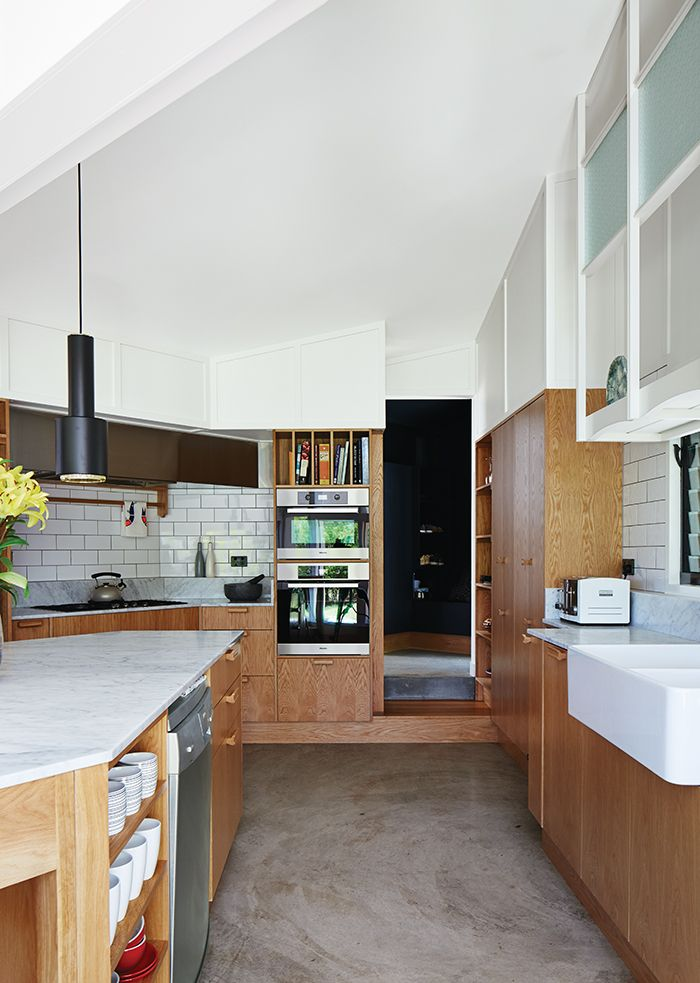 Modern timber house kitchen with tiles, custom oak veneer cabinetry
