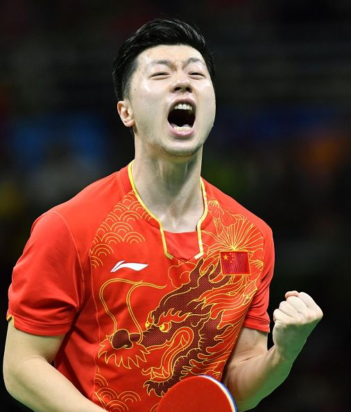 #RIO2016 China's Ma Long celebrates after defeating compatriot Zhang Jike in the men's singles table tennis gold medal match at the Rio de Janeiro Olympics on...