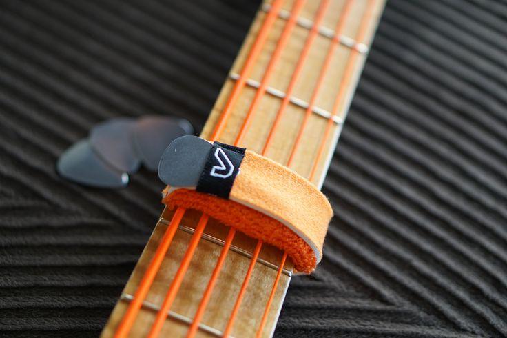 Fretwraps holding guitar pick skateboard guitar pick