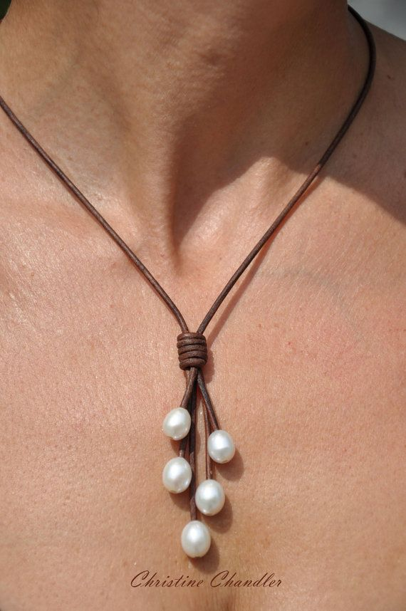 This beautiful Pearl and Leather Lariat necklace goes perfect with any wardrobe choice. There are 5 AAA quality 12mm rice pearls on fine quality 2mm antiqued leather. It is available in many leather colors.  There are 2 choices in style: (Let me know in comments when ordering.)  1. A fixed length with a 12mm pearl button clasp making the necklace part hang 18 inches while the Lariat parts hang to 2 3/4 more inches. 2. Two sliding pearl knots giving you a variety of lengths being short to 40…