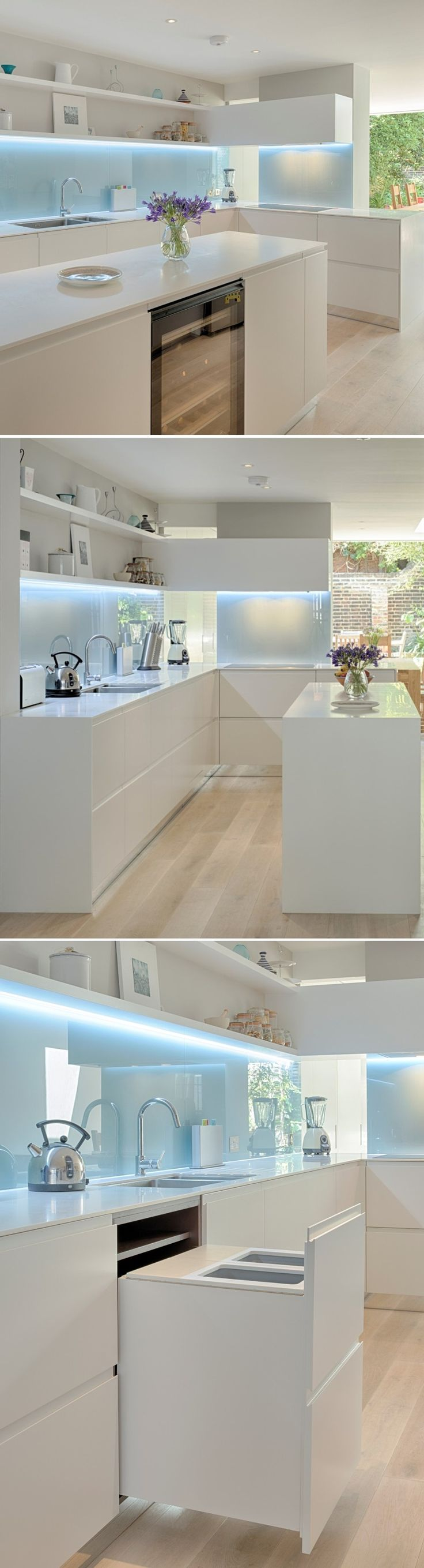 INTERIOR-iD Kitchen in coloured satin matt lacquer with glacier white corian worktop and back painted glass splashback. Design by MWAI Architects.