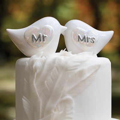 White porcelain birds with pearlized heart designs featuring Mr. and  Mrs. in silver.