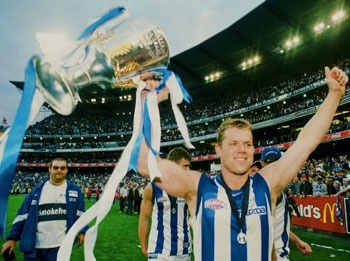 To be there when North Melbourne win their next Premiership