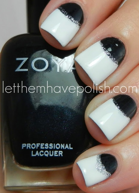 White nails with black half moons accented with silver glitter nail art design