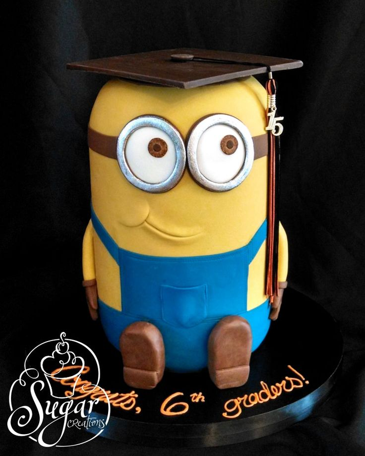 minion graduation cake -- For my youngest son's 6th grade promotion ceremony!  There were 3 tiers of cake inside.
