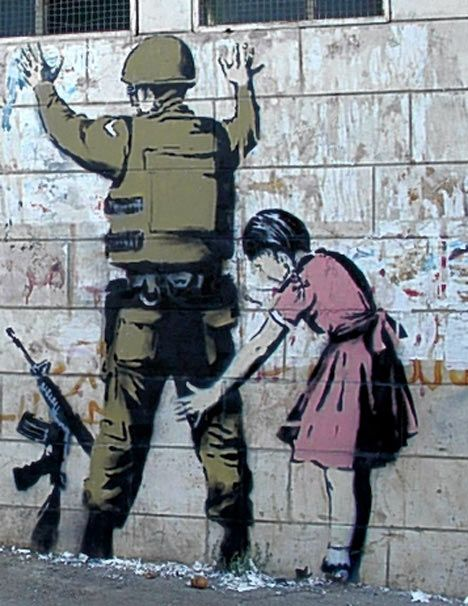 """Elusive graffiti artist Banksy has struck again, this time in the Holy Land in Bethlehem. Six new images, including a dove wearing a flak jacket and a soldier being frisked by a young girl."""