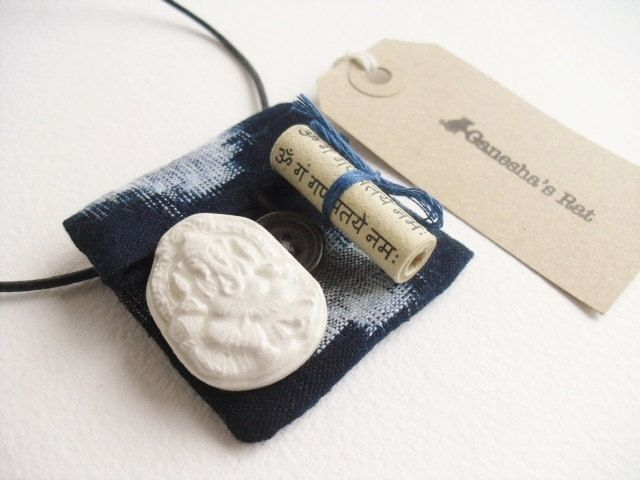 Handmade Ganesh amulet pendant, talisman pouch, unique cream clay Ganesh relief & sacred mantras in handmade indigo pouch, boho pendant by GaneshasRat on Etsy