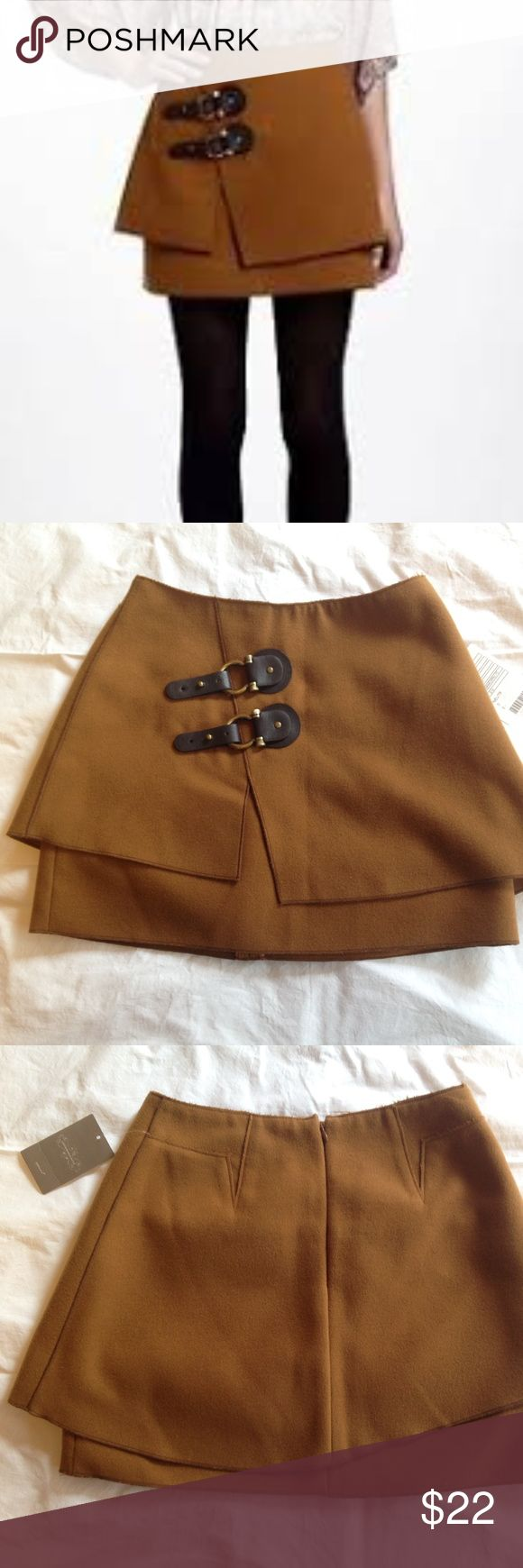 Anthropologie Meadow Rue Felt Buckle Mini Skirt 0 Anthropologie Meadow Rue mini skirt.  •Camel color felt material with buckle details at front.  •New with tag. Pristine condition.  •Size 0.  •Invisible zipper at center back.  •95% poly 3% viscose 2% spandex. Hand wash cold.   Measurements: Length at center front is 14.5 inches  Width at waist (measured at top edge on the half) is 12.5 inches Anthropologie Skirts Mini