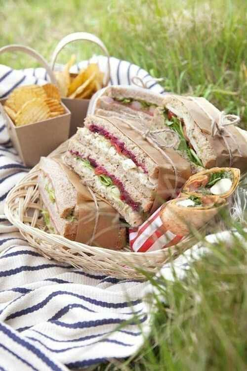 Brown paper and string wrapped sandwiches.