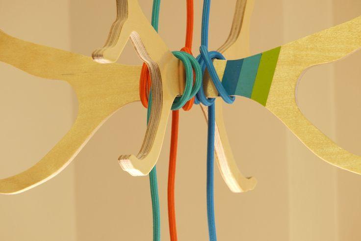 Colourful pendant light cords wrapped around Elk Antler hanger. longwkd.com