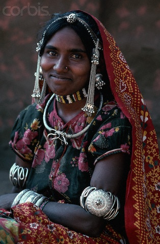 Jhabua, India    Bhil Woman in Traditional Dress © Lindsay Hebberd/Corbis - I love that she looks like she's trying not to laugh; a lot of my photos look like this.