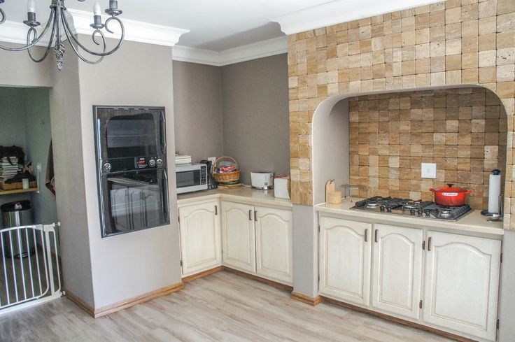 Kitchen with built-in oven and hob.