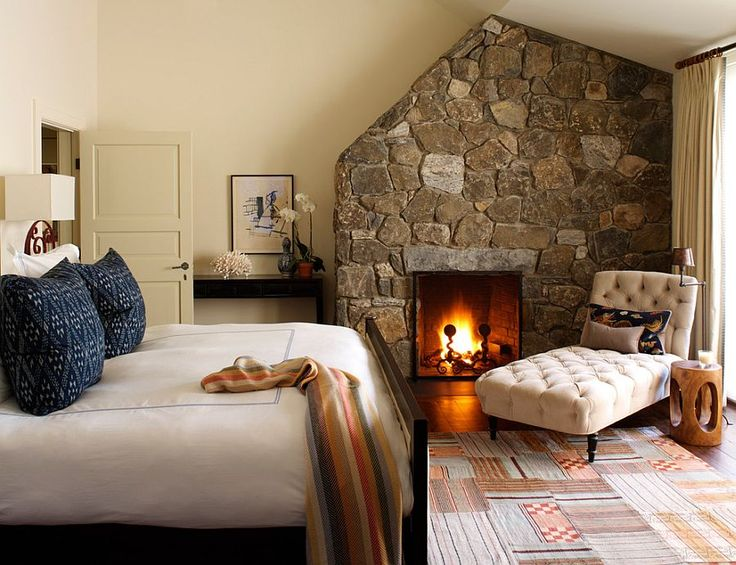 A chaise by the open fire, a rustic stone wall, throws, cushions and a floor rug set the perfect winter scene. Photo credit- decoist.com