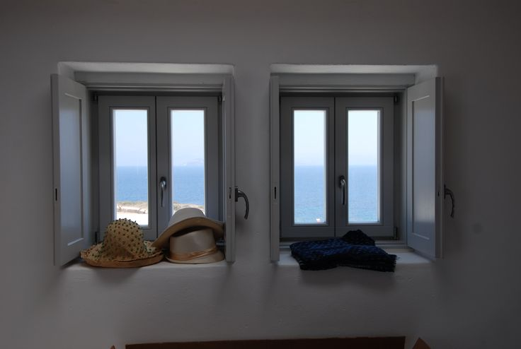 Take your hat and go for a swim in the beautiful island of Paros, Greece! Accoya wood window frames and shutters.