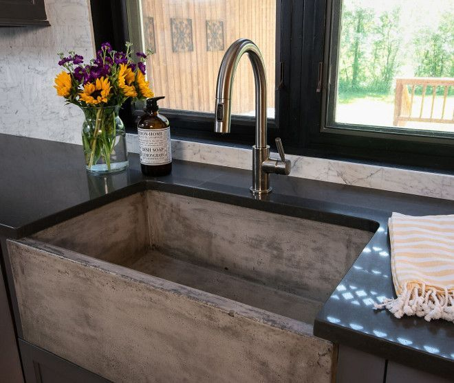 the kitchen also features a virtually farmhouse sink made of sealed concrete it looks