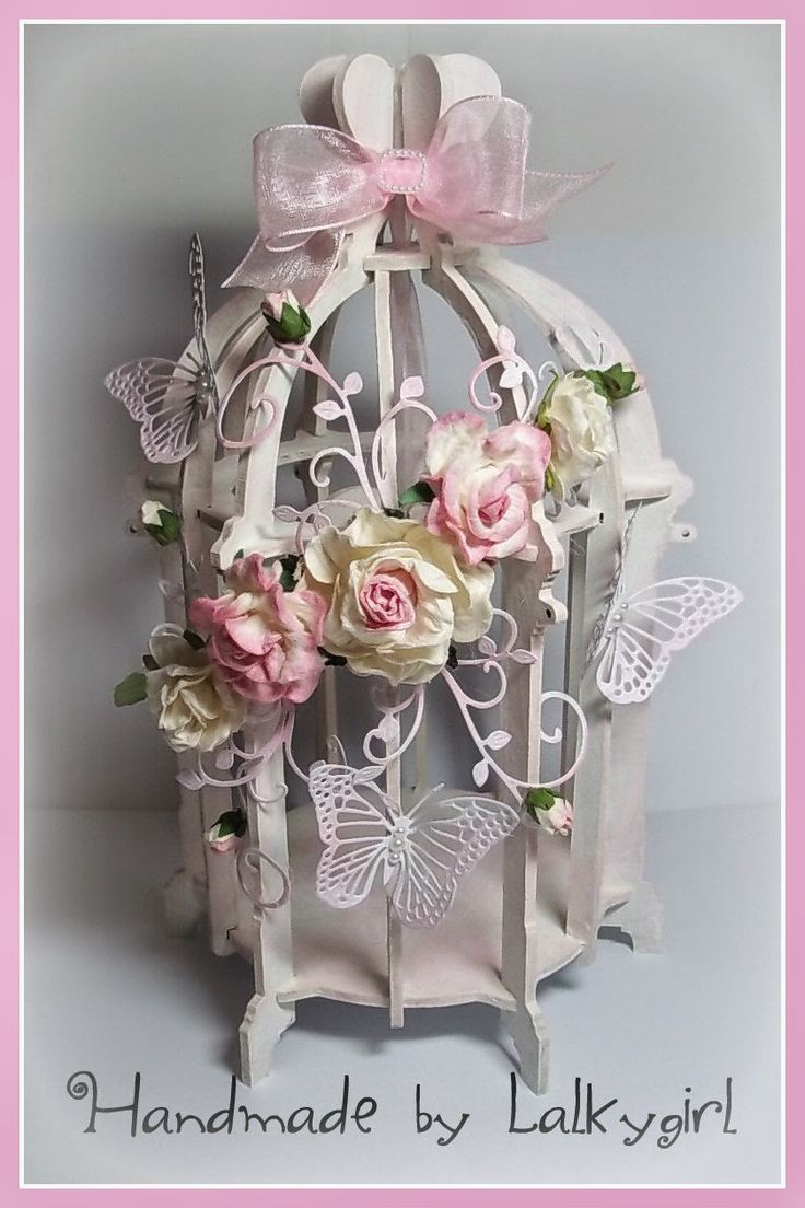 A birdcage I have altered using cheery lynn dies,mulberry crafts flowers and acrylic paint ...distressed with TH distress ink the birdcage  kit is from candy box crafts