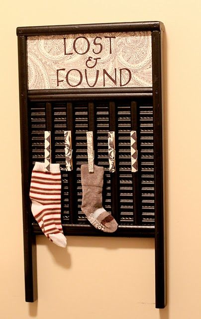 DIY lost and found board. Could be used for no named papers with a bucket underneath for larger items.