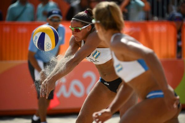 Argentina's Georgina Klug (L) hits the ball during the women's beach volleyball qualifying match between Brazil and Argentina at the Beach Volley Arena in Rio de Janeiro on August 8, 2016, for the Rio 2016 Olympic Games.