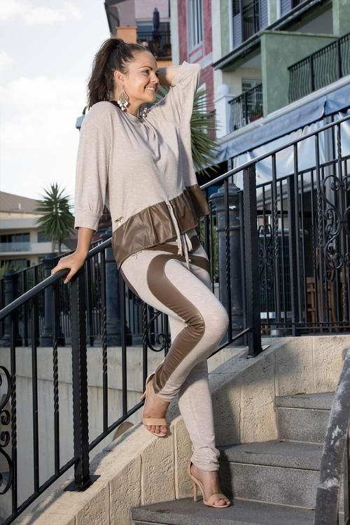 Coco Faux Leather Pant - This super soft, stretch, straight leg pant is comfort with an edge. It has a criss cross design from the waist to the ankle and back pockets in a gorgeous coco Faux leather.