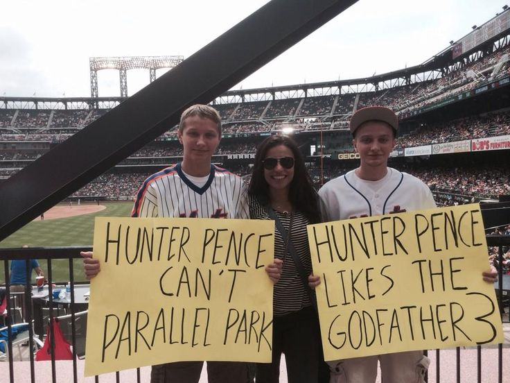8/3/14 in New York: Hunter Pence's girlfriend Alexis Cozombolidis poses with the two guys who started the whole #HunterPenceSigns trend that is sweeping through ballparks across the country.