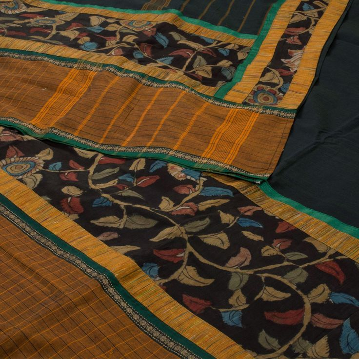 """The """"Black"""" #handpainted Kalamkari Chettinad Cotton Sari from Parisera is set off by a brown border with Kalamkari design. Attractive painted multicolour floral motifs adorn the pallu. The border is repeated on the green blouse that completes the sari."""