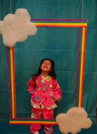 Look at this CUTIE PIE. Love the PJs + rainbow and cloud framed DIY photo booth. Magical idea for party people of all ages.
