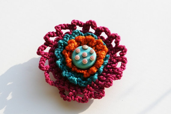 Crocheted lampwork glass brooch by evasmidt on Etsy, $25.00