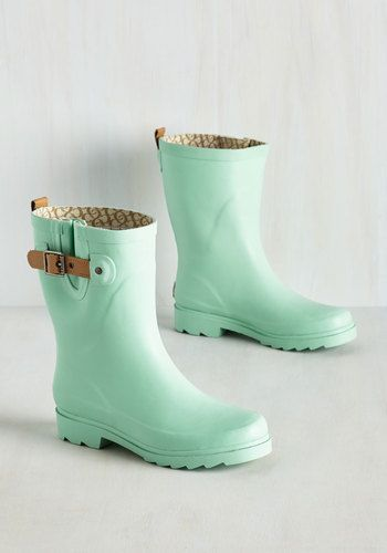 On a rainy morning, will you opt to drive to work? Of course not! You stick to your usual walking route wearing these pastel mint rain boots! Rising to a cute calf height and adorned with a light brown, leather buckle strap, this pair allows you to adorably carry on as usual.
