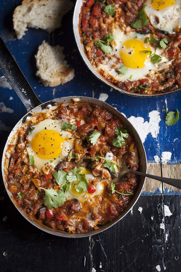 Shakshuka with eggs,  mushrooms and spinach. Shukshuka originates from Tunisia.