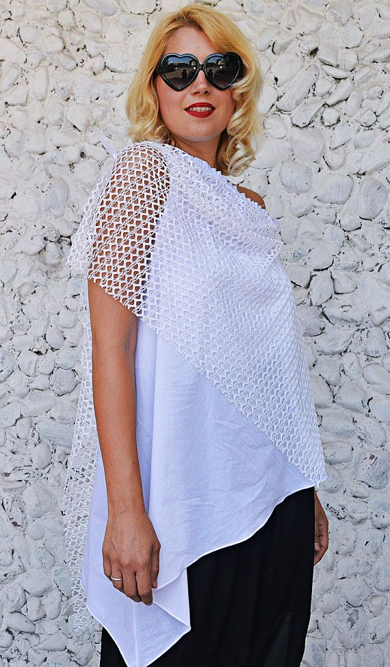White summer top made of a mixture of cotton and soft lace with an asymmetrical cut. Twisted and unique summer blouse, easy to wear and versatile. Material: 95% cotton, 5% elastane + 100% soft lace Care instructions: Wash at 30 degrees  The model in the picture is size S.  Can be made in ALL SIZES.  If you have any other specific requirements, do not hesitate to contact me!  I DO NOT CHARGE EXTRA MONEY for custom made items.   All you need to do is send me your measurements. Below, you will…