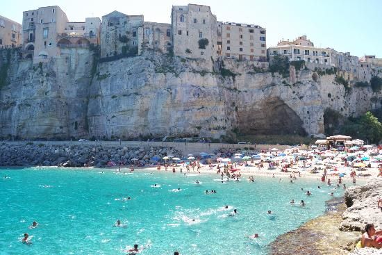 Escape to these breathtaking beaches: Tropea Beach, Italy.  Clean, Blue waters and a beautiful town to wander in...  www.facebook.com/loveswish
