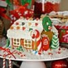 Christmas cookie exchange ideas: Gingerbread house  Gingerbread houses are a traditional Christmas delight that your guests will marvel at. It's easy to build a house using a pre-made gingerbread house kit. The kit comes with everything you need to make the house shown here. Place your masterpiece on a raised platter so that it gets the attention it deserves. Scatter shredded coconut around your house to look like snow