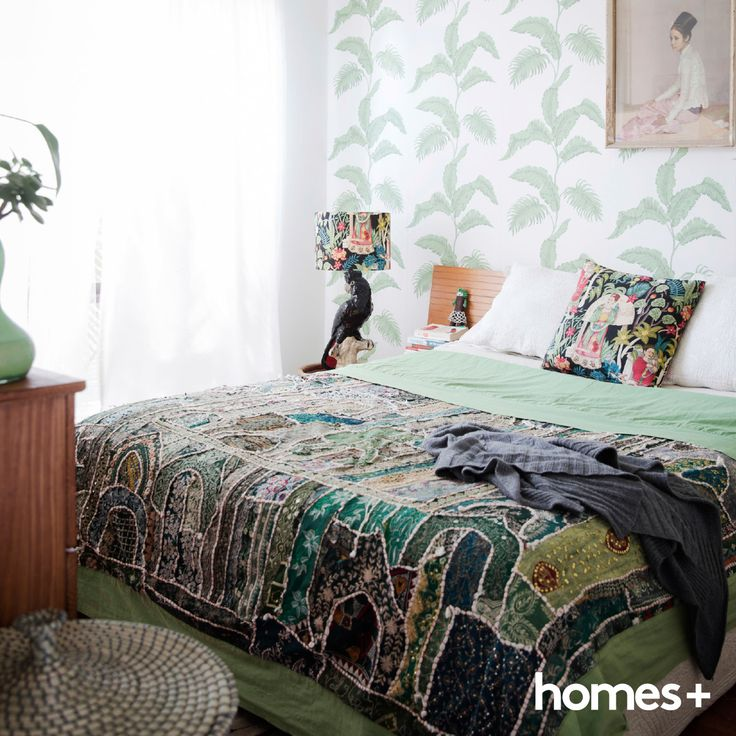 Karen has incorporated #mint #green throughout her home. As featured in the May 2015 issue of homes+. #bedroom #bed #feature #wall #wallpaper #lamp #pouf #green #cushion #pillow #decor #style #interior #home #beachhouse #beachy #homesplusmag #artwork #art