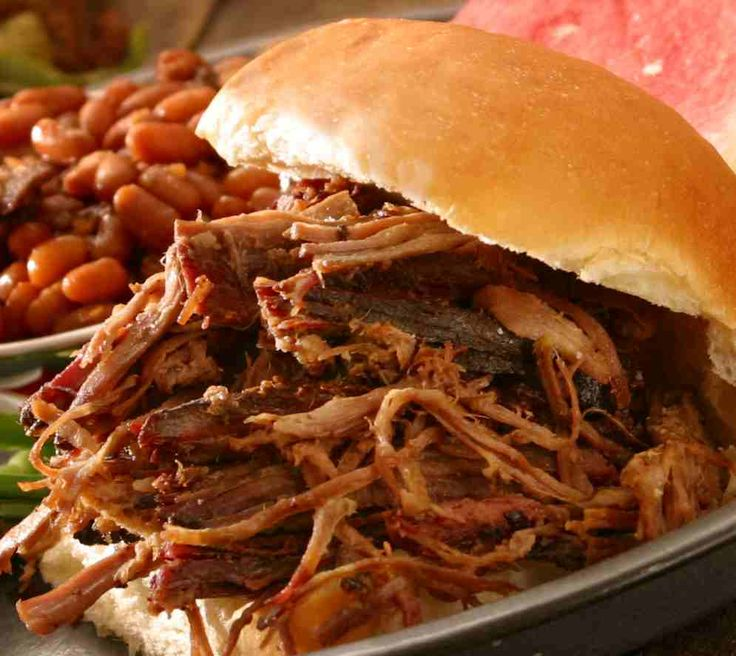 Easy BBQ Beef Sandwiches :: 2-3 lbs chuck roast, 1 bottle chili sauce, 1 envelope dried onion soup mix, 12 oz can cola - Combine all ingredients in crock pot; cook on low for 8-10 hours. Don't lift the lid! Shred cooked beef and serve in buns.