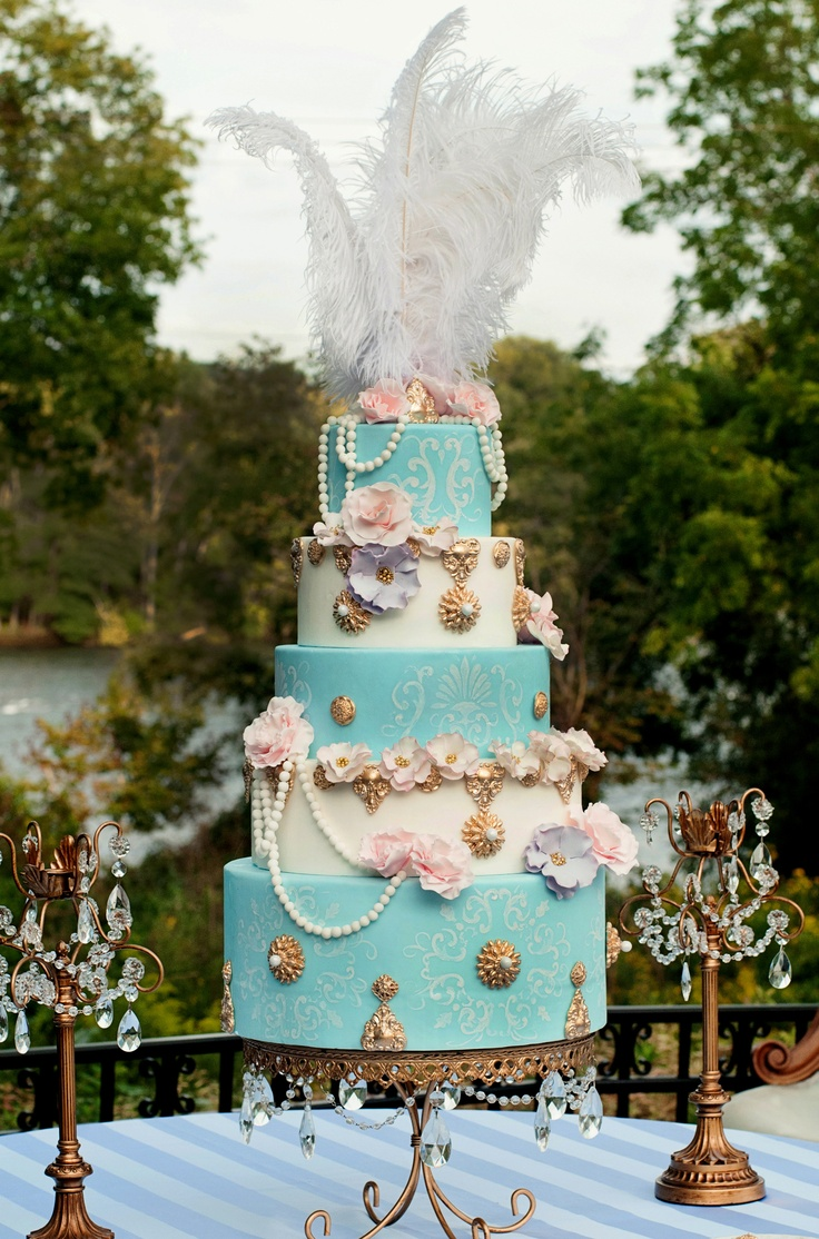 A cake fit for Marie Antoinette herself! Gumpaste flowers, hand rolled and strung pearls, gumpaste brooches embellished with sixlet pears (yum)..and handpainted stencil wallpaper type motifs on the blue! www.skysthelimitcake.com Photography: christifallsphotography.com