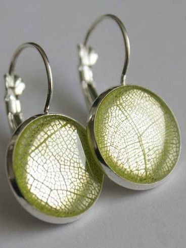 Green Skeleton Leaf Earrings | This jewellery features hand picked and pressed plants grown in a greenhouse by the designer herself! Some pieces also feature foraged natural items such as ferns, lichen and moss, leaves, and seashells gathered from Eastern Quebec and the Bas St-Laurent region. #torontofashion #CanadianDesigners #canadianfashion #canadianfashionblogger #madeincanada #canadiandesigner #canadianbrands #jewellery #torontojewelry #canadian #earrings  #madeinquebec