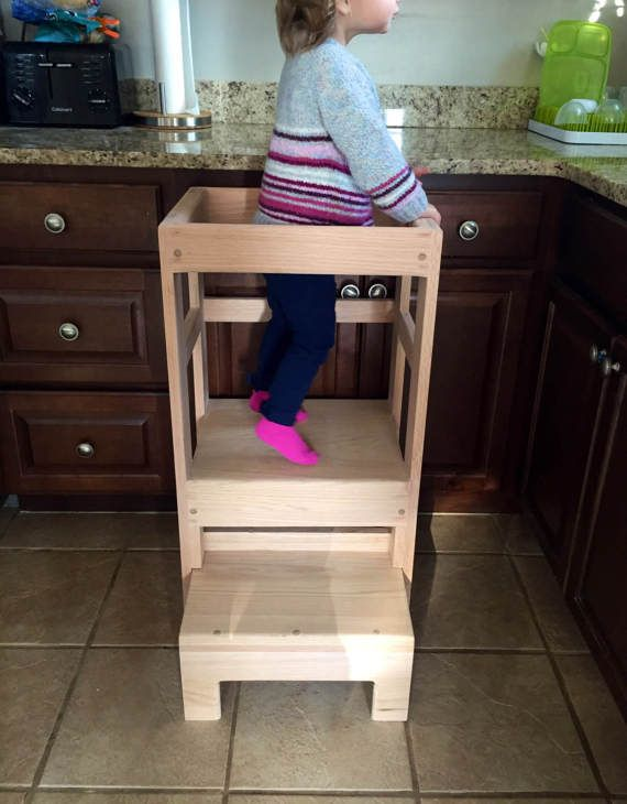 This is a childs red oak kitchen stool for kids around ages 2-4. The stool is 33 inches high and allows your kid to help you in the kitchen. Your kid can walk up the step and get on the stool and reach the counter! The bottom step slides in for easy storage. This would be a great kitchen gift. Can be stained and polyurethaned or unfinished  Measures 33 high, 17x15.5 First step is at 7 second at 13.5 Built out of quality red oak lumber and built strong. Children must be monitored at all…