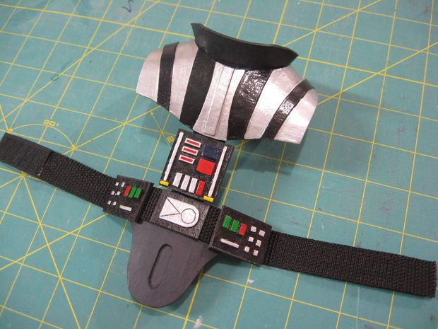 Picture of Vader's belt and shoulder pieces, and face