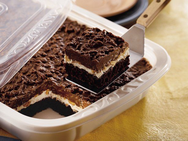 Everything thats irresistible about a good candy bar just got rolled into one recipe. Whats your favorite part? The brownies on the bottom? The frosting and peanuts in the middle? Or the crunchy cereal on the top?