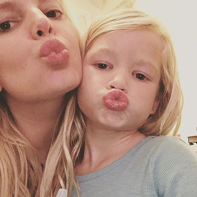 Jessica Simpson makes a duck face on Instagram with her young daughter.