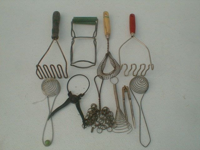 A Collection Of Ten Vintage Kitchen Utensils Including Wooden Handle  Mashers,pot Scrubers,jar