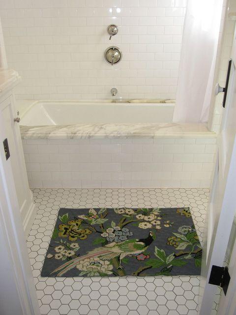 jenika home tour - apartment therapy - marble tub surround