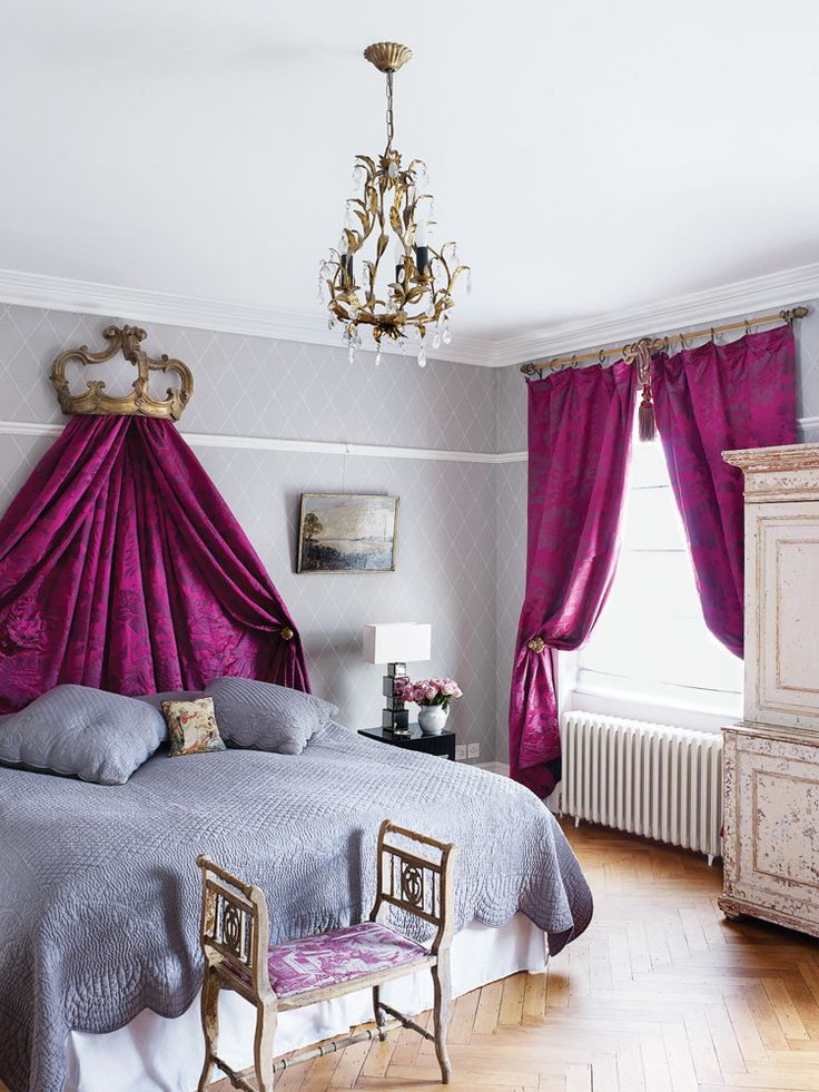 Neutral walls and linens allow brilliantly bold drapery to serve as the focal point in this posh master bedroom. #beds #purple #curtains