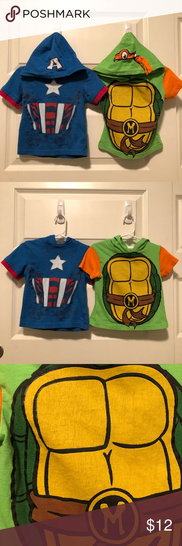 2 Hoodie Tees Captain American TMNT 18 month This listing is for two tees- the one on the left is blue and Captain America themed, while the one on the right is green and Teenage Mutant Ninja Turtle themed. Both gently worn without stains or holes, but some wear to the decoration- see photos for fabric closeup. Both short sleeved with adorable themed hoods, size 18 month. Shirts & Tops Tees - Short Sleeve