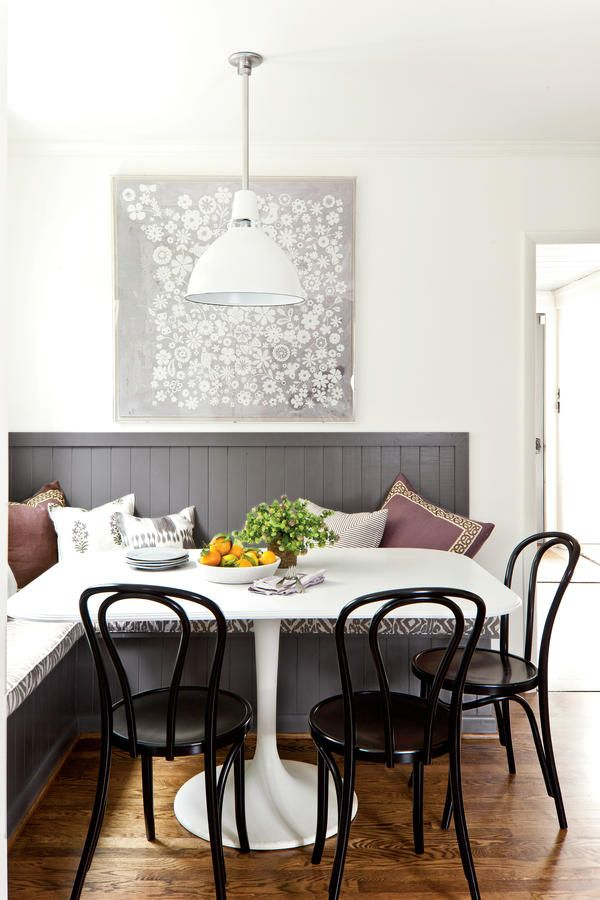 "Inviting Breakfast Nook - The Classic Kid-Friendly Kitchen - Southernliving. Custom Banquette  ""Make every inch count with an L-shaped bench,"" says Jessica. ""Mine is made of MDF with tongue-and-groove paneling for dimension.""     Comfy"